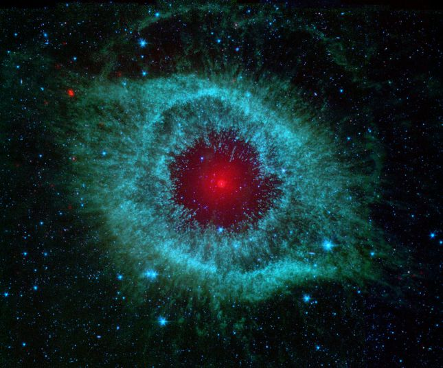 Comets_Kick_up_Dust_in_Helix_Nebula_(PIA09178)